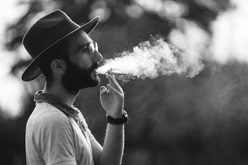 Black and White Photo of a Man Smoking