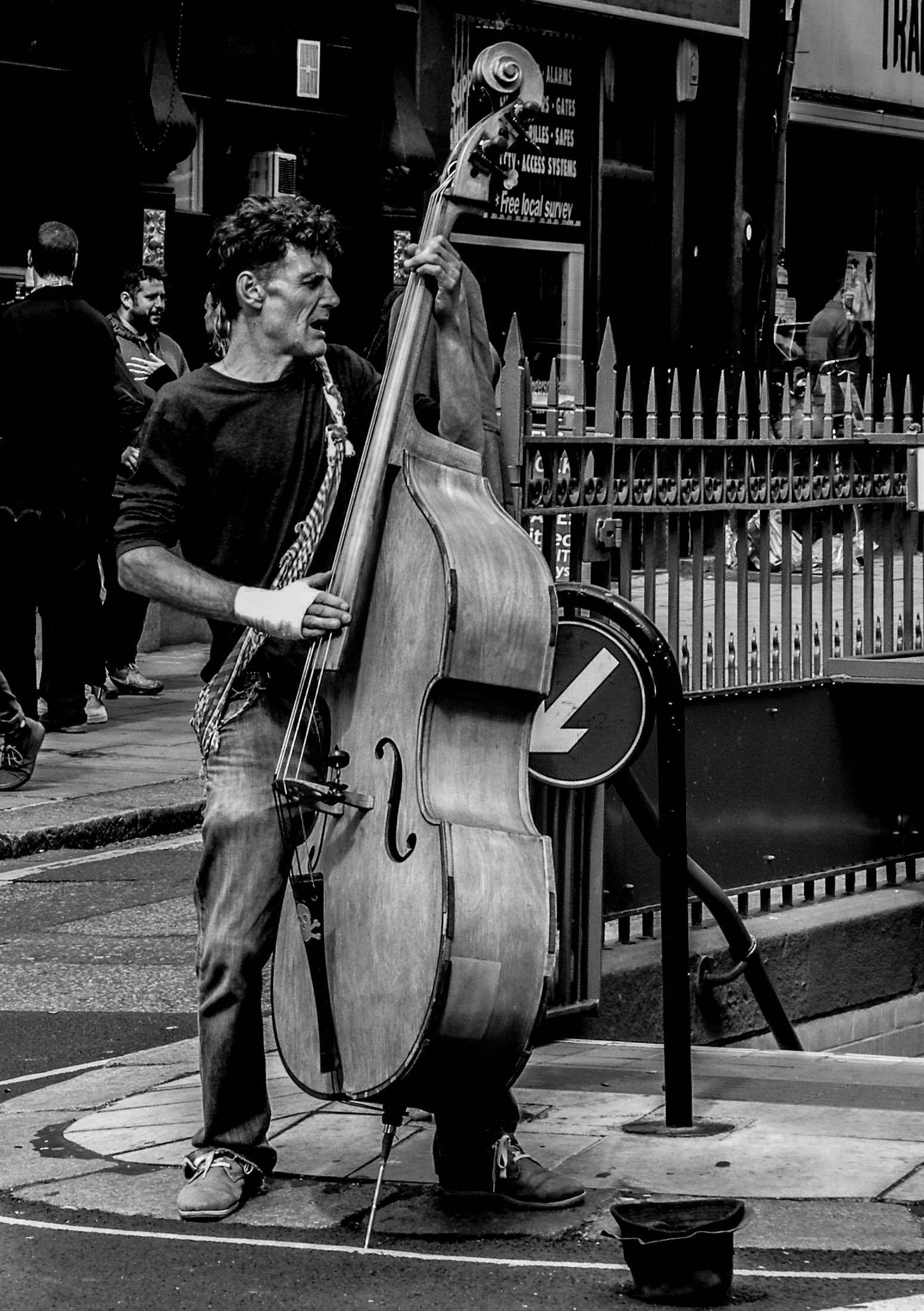 Grayscale Photography of Man Playing Cello
