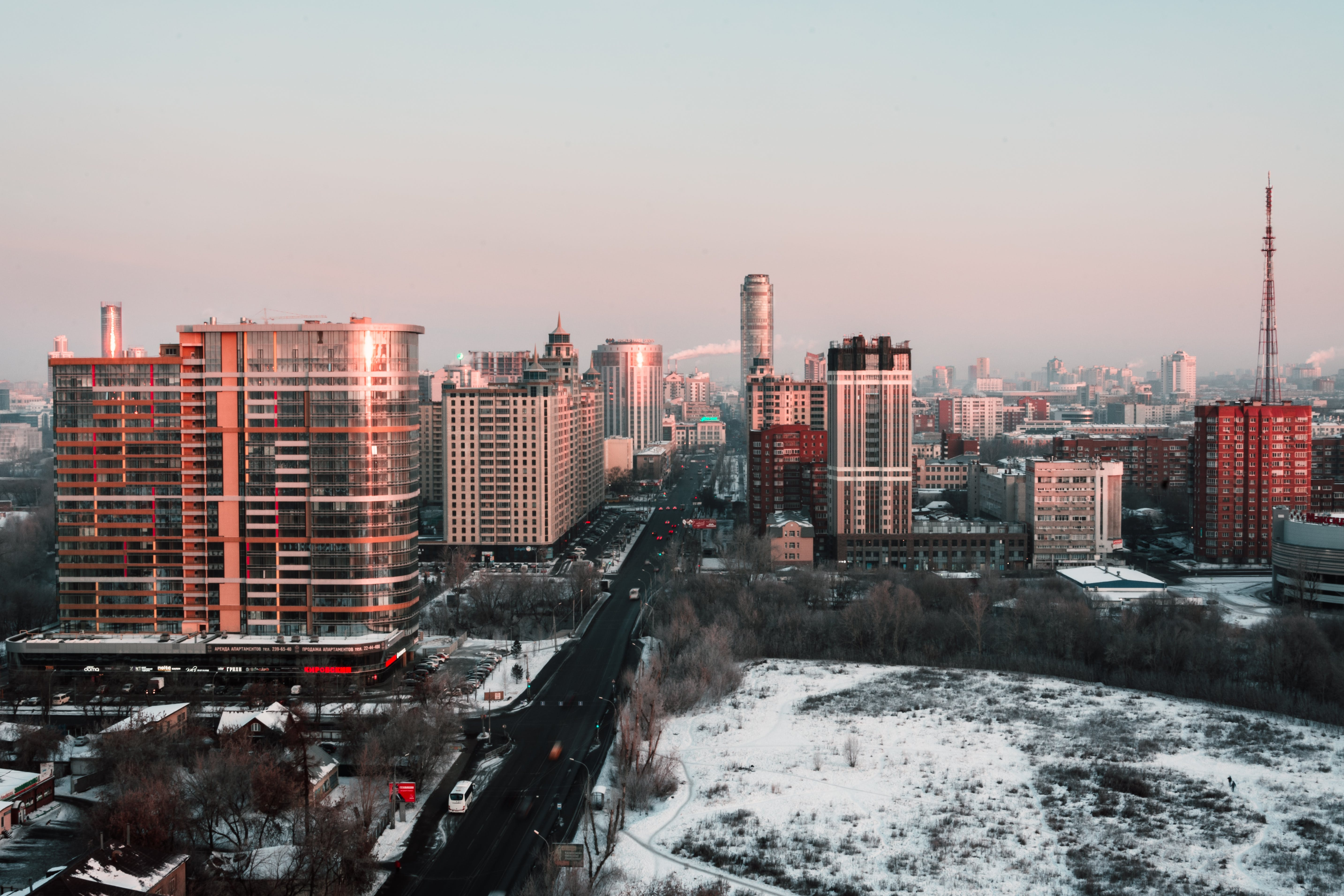 White and Red High-rise Building during Winter Season