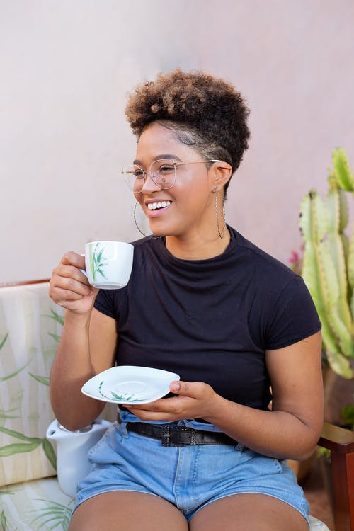 A Woman with Short Hair Drinking Coffee