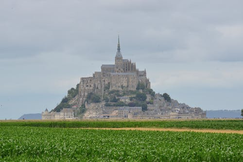 Mont Saint-michel Under White Clouds and Blue Sky