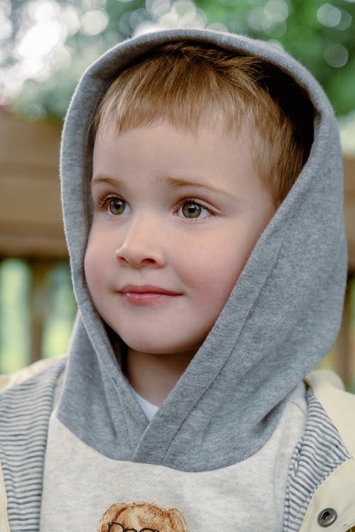 Little Boy in Gray Hoodie Smiling