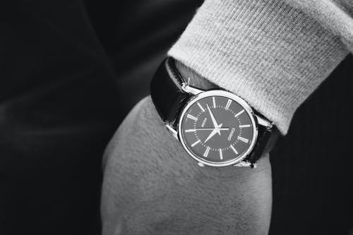 Person Wearing Round Silver Analog Watch With Black Leather Strap