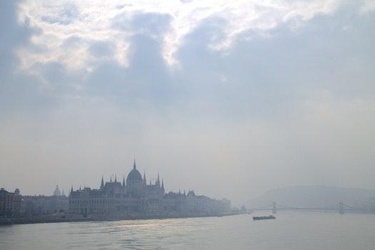 Free stock photo of clouds, sun, bridge, boat