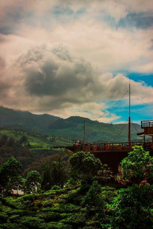 Free stock photo of 50mm, cloud, dark green, green field