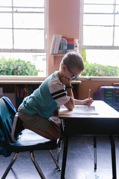 Photo of a Boy Doing His Homework