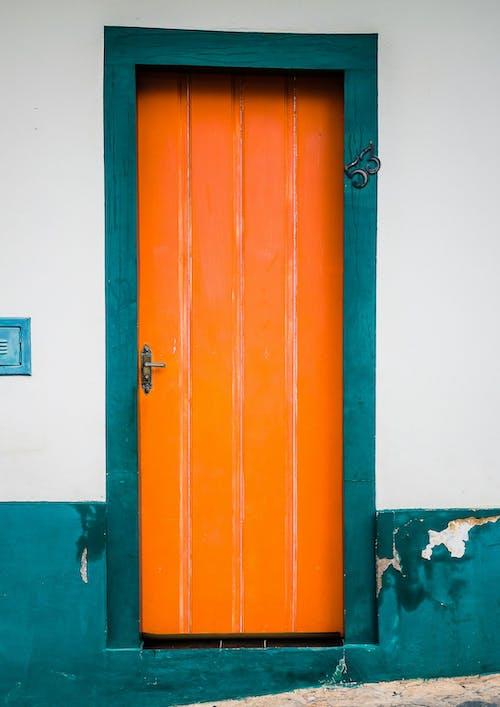 Photo of an Orange Wooden Door