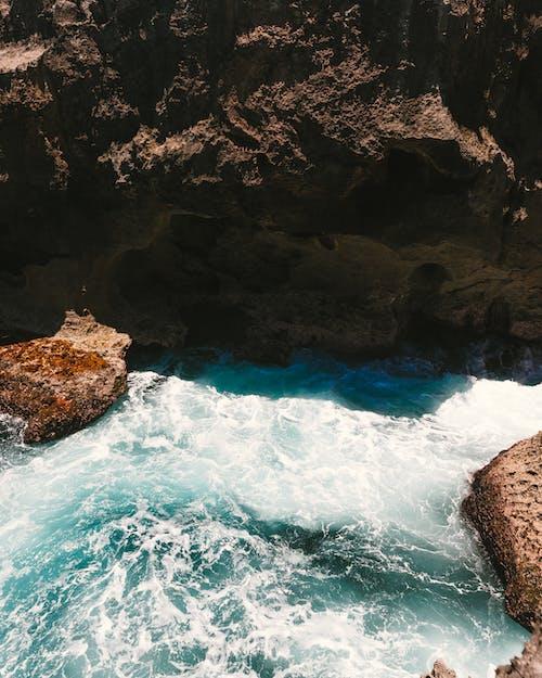 Brown Rock Formation Beside Blue Sea