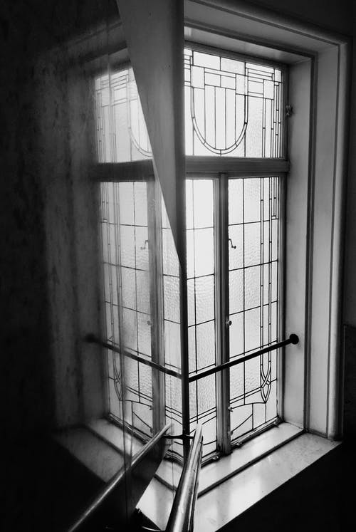 Grayscale Photo of a Window