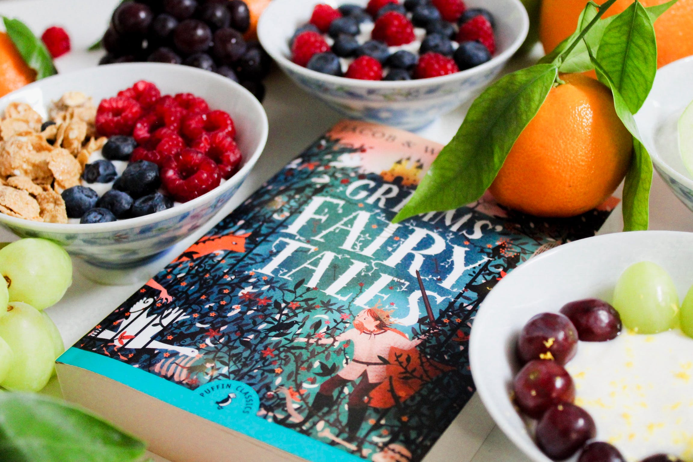 Grimms Fairy Tales Book Surrounded by Fruits