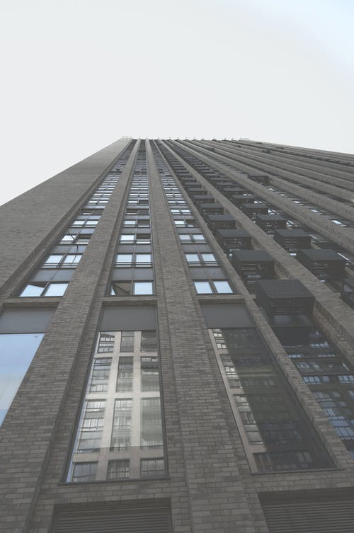 Low-Angle Shot of Tall Concrete Building