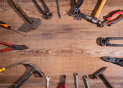 Hand Tools on Wooden Surface