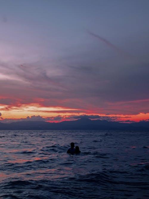 オレンジ色の空, シルエット, ビーチの無料の写真素材
