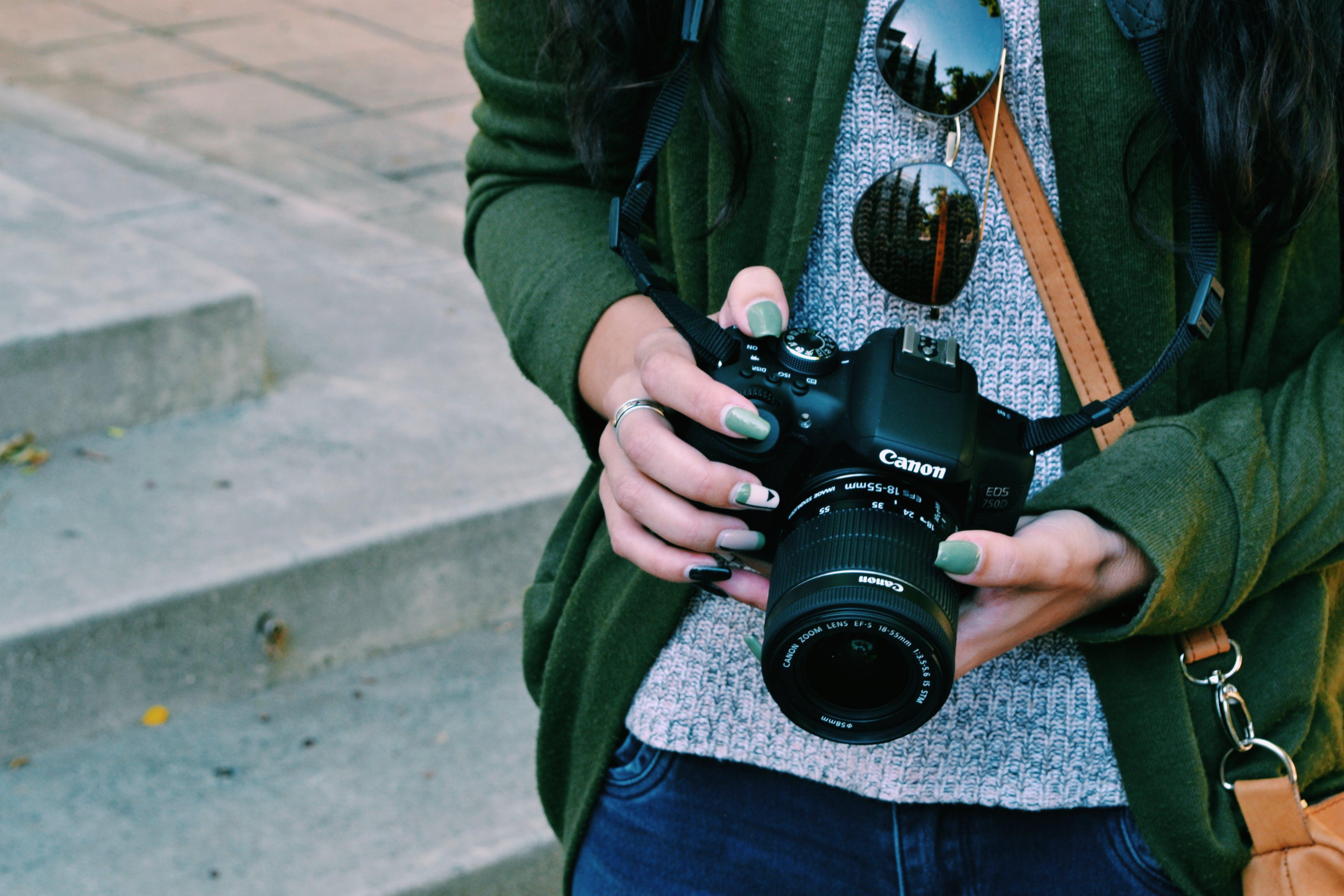 Woman Holding Black Canon Dslr Camera