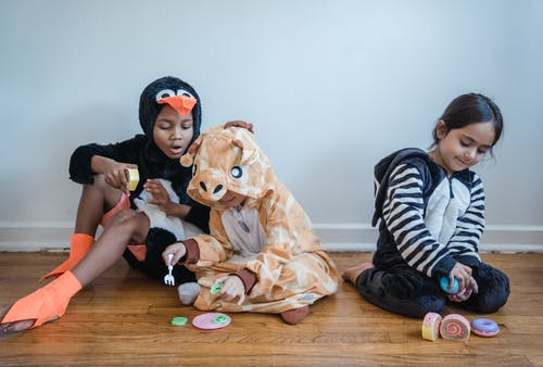 Kids in Animal Costumes Playing Toys on the Floor