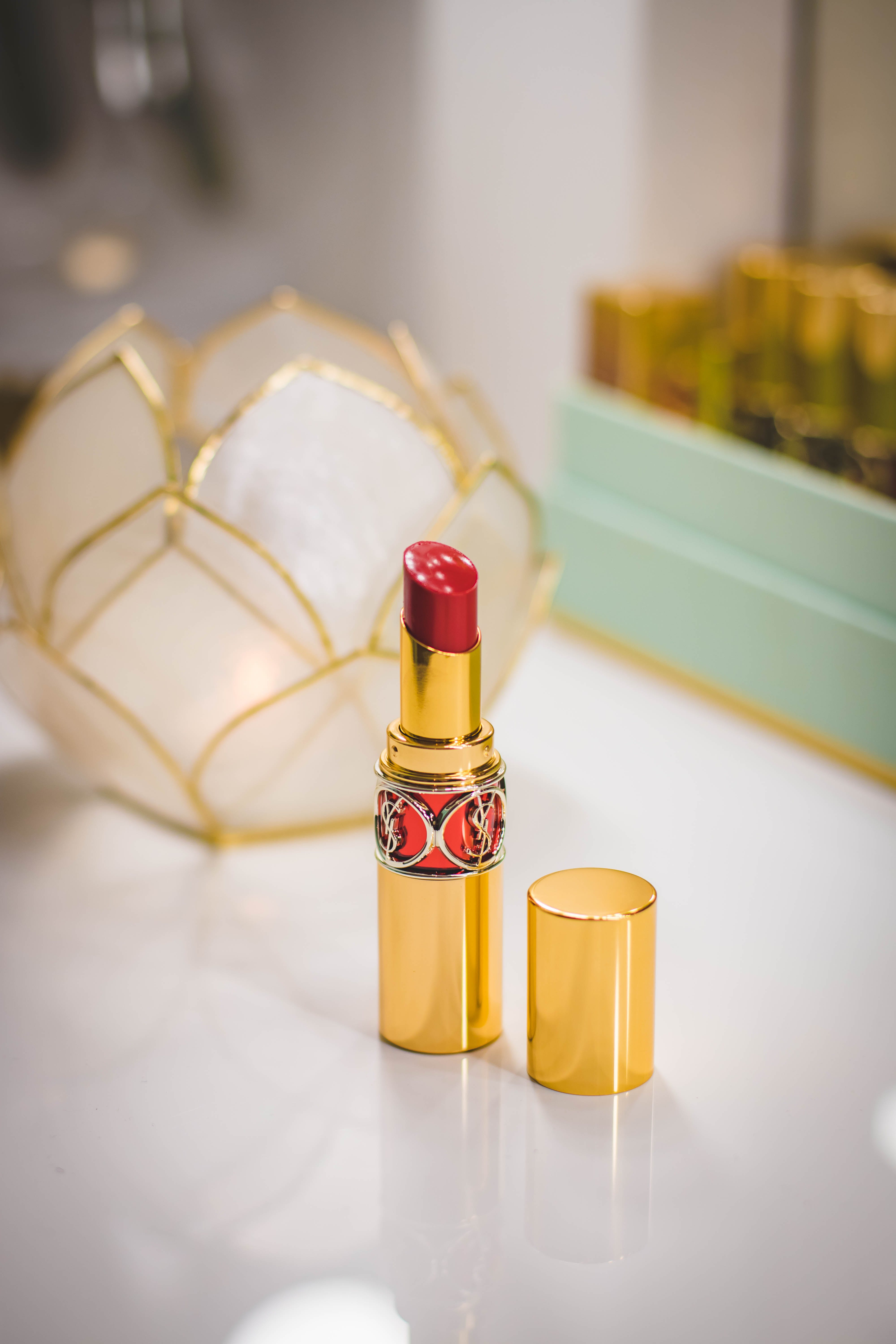 Close-Up Photography of Red Lipstick on Desk