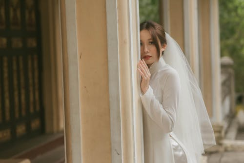 Bride in White Dress Align to Wall