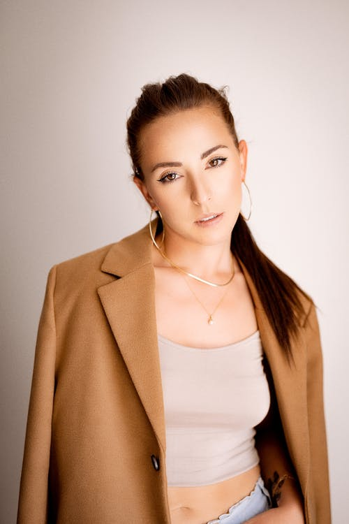Woman in Brown Blazer and White Tank Top