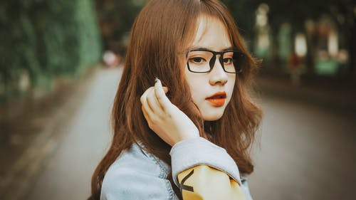 Close-Up Shot of a Pretty Woman with Eyeglasses