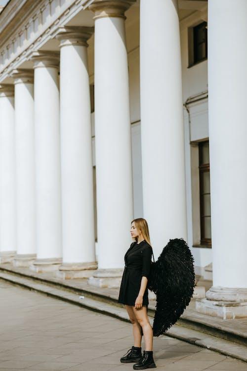An Angel Standing near the Columns
