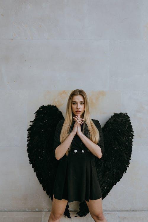 A Woman Wearing an Angel Costume