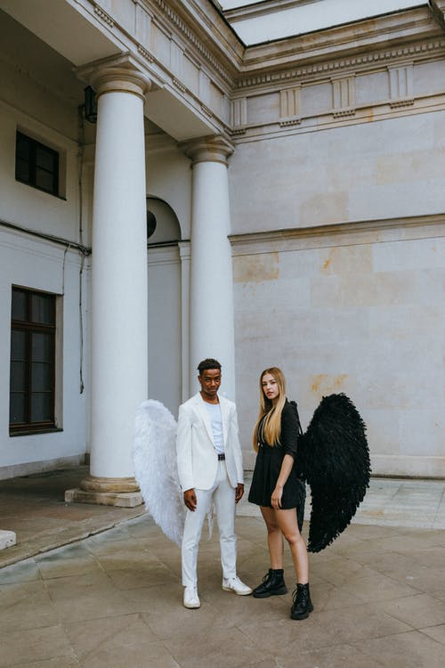 A Man and Woman Wearing Angel Costumes