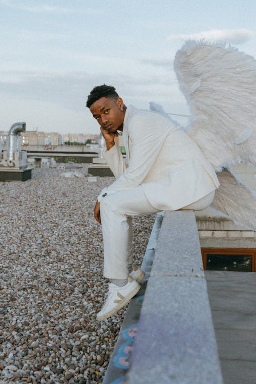 A Man Wearing an Angel Costume