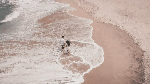 Aerial View of a Couple in the Seashore
