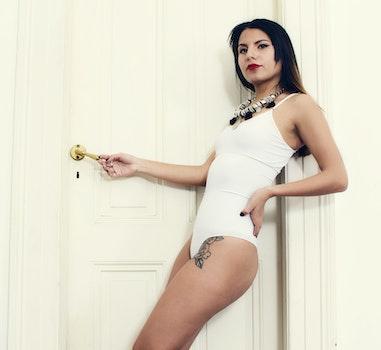 Woman Wearing Swimsuit Leaning on Wall