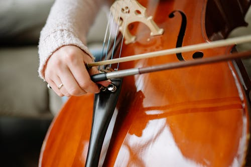 Close-Up Shot of a Person Playing a Cello