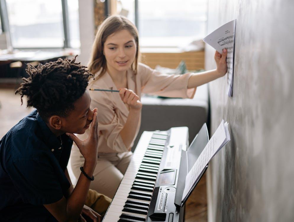 Man and Woman Playing Piano