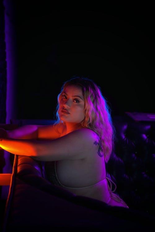 Woman in Black Tank Top Sitting on Chair