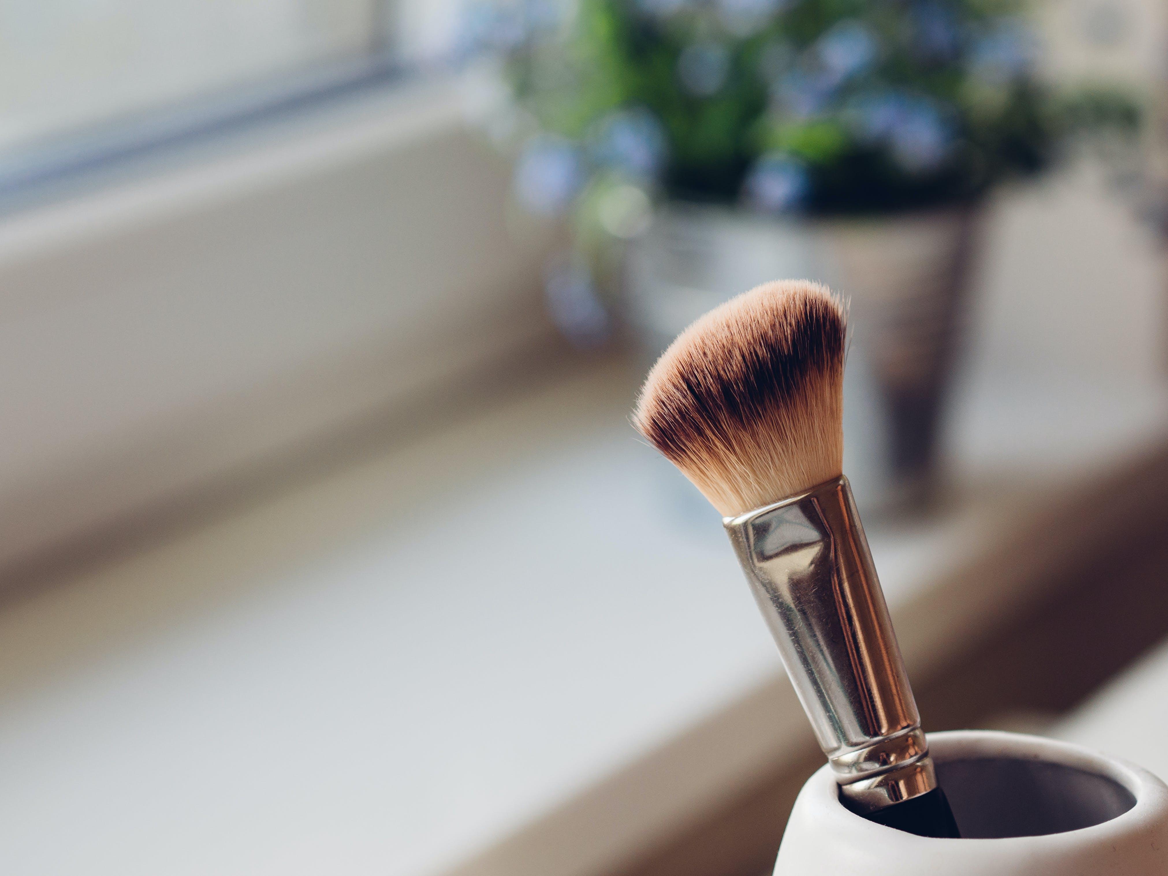 Shallow Focus Photography of Makeup Brush