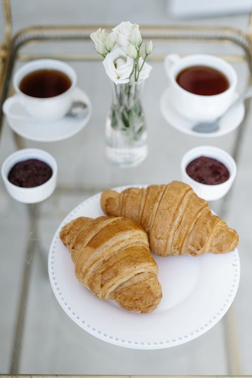 Close-Up Shot of Croissants on a White Plate