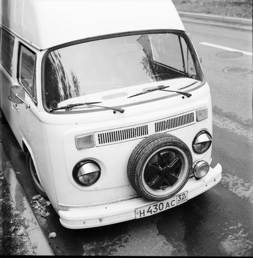 Grayscale Photo of a Van