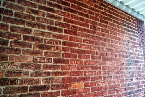 Free stock photo of brick wall, brickwall, names, urban