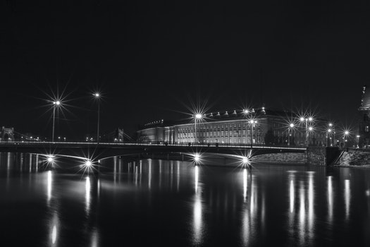White Building Near Bridge With Lights