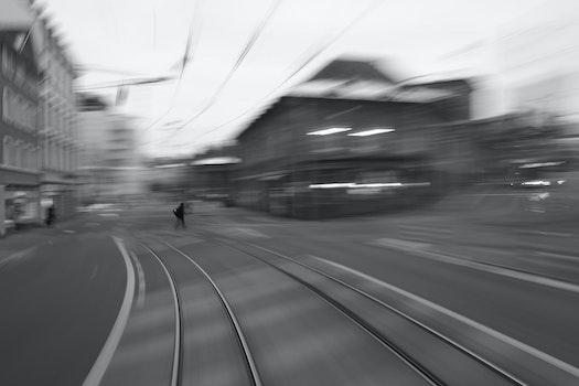 Free stock photo of city, man, street, tram