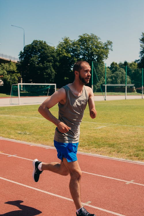 A Man Running on the Track