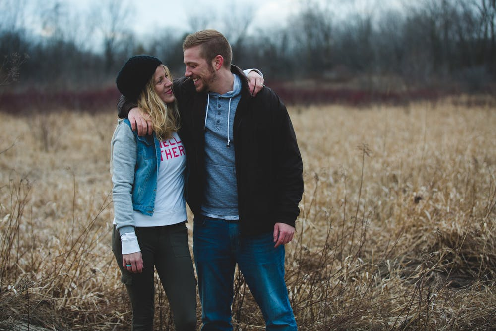A woman and a man smiled at each other near the field. | Photo: Pexels