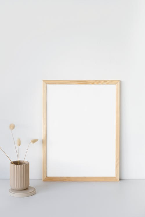 Brown Wooden Frame on White Wall