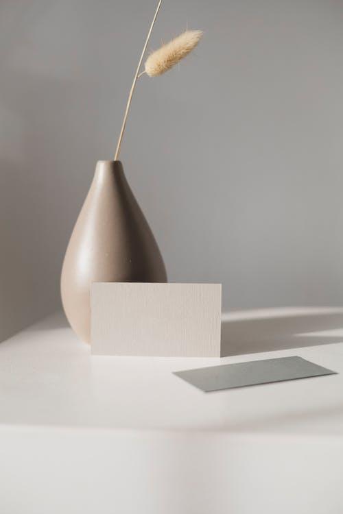 Brown and White Ceramic Vase on White Table