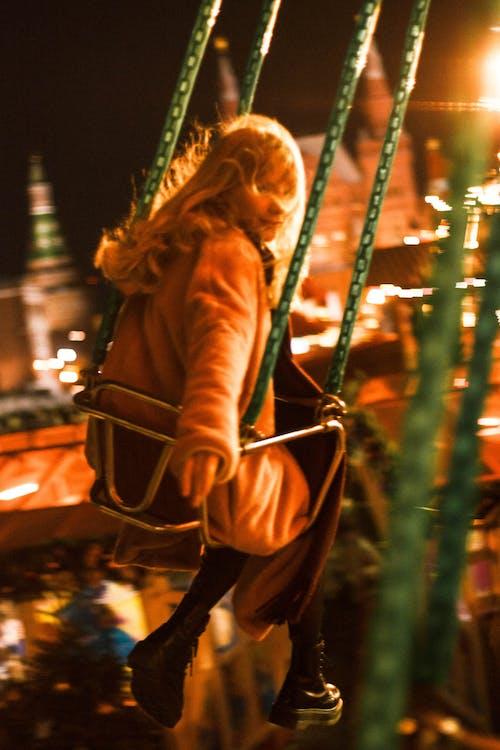 Woman Sitting on Steel  Framed Swing