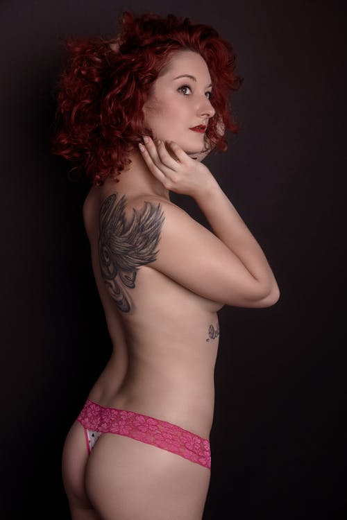 Redhead Woman in Pink Laced Thong with Tattoo on Back