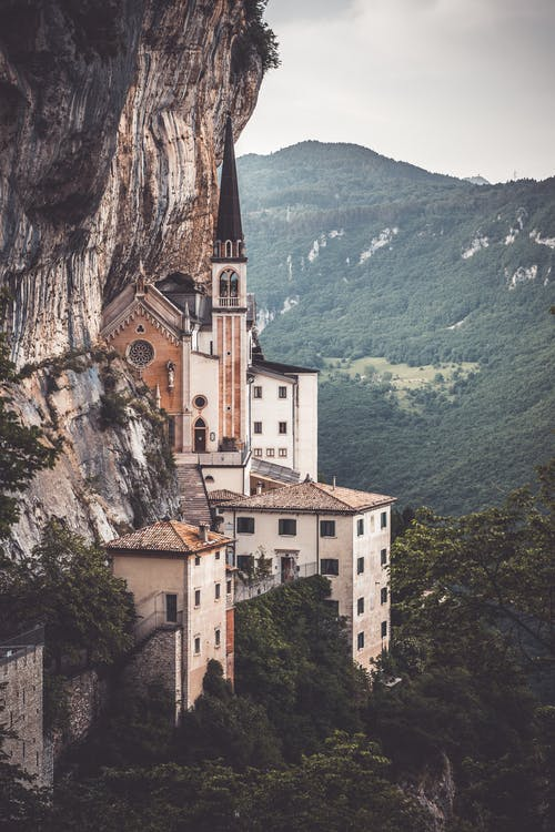 Brown and White Concrete Building on Cliff