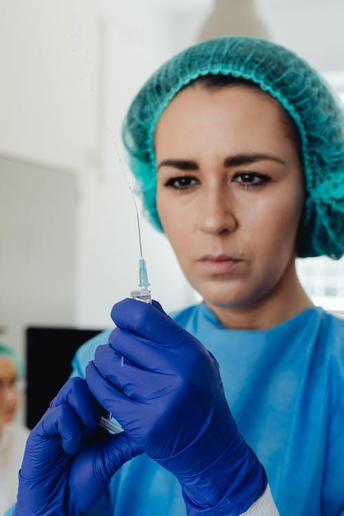 Woman Holding a Syringe