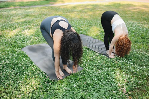 Woman Yoga in the Grass
