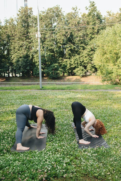 Two Women Stretching Their Bodies