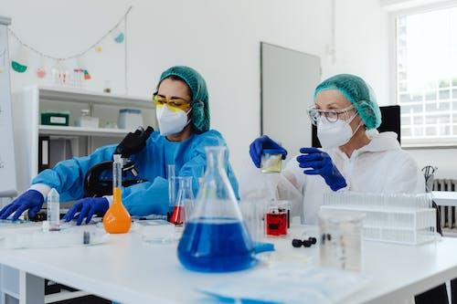 Women Analyzing Samples