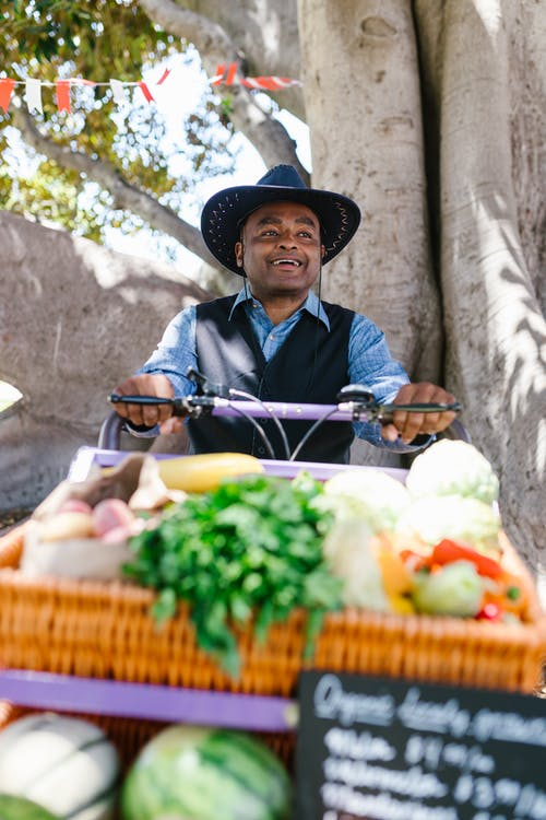 A Smiling Man Selling Organic Vegetables
